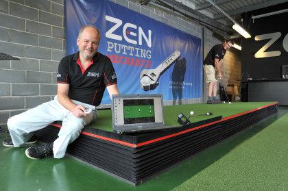Nick Middleton, Managing Director of Zen Oracle, tests his robotic putting green
