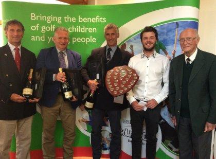 Winning Pro-Am team 'The Kent Massive' receives The Wickham Shield from The European Tour's Hugh Wickham