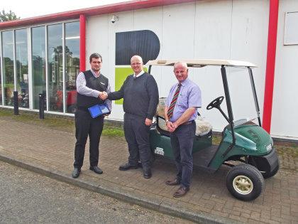 E-Z-GO's Andrew Bourke (left) presents the UK Dealer Award to David Common and Alistair McRobert