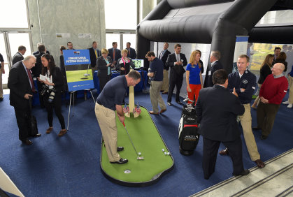 "Michael Breed (pictured right) gives Congressional Members and staffers free lessons throughout the day in a simulator. The ""Republicans vs. Democrats"" putting challenge is now an annual event (Photo by Stan Badz/PGA TOUR)"