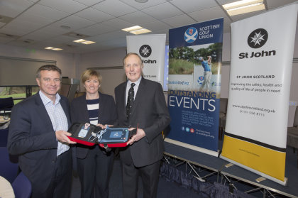 St Johns donate a mobile defibrillator to Hamish Grey, Chief Executive SGU and Karin Sharp, Chief Operating Officer SLGA as part of an initiative to introduce them into golf clubs (Kenny Smith Photography)