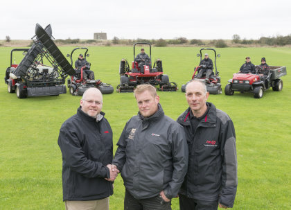 Head greenkeeper Glenn Rayfield, centre, with Lely's Julian Copping, left, and Andy Branton of TNS Group