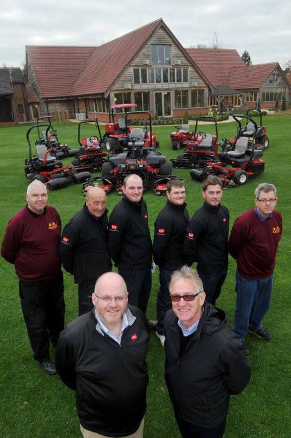 Adrian Hurst, managing director at Tydd St Giles, front right, with Lely's Julian Copping and the club's greenkeepers