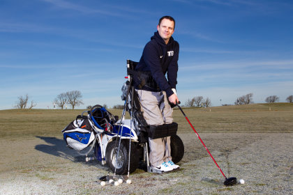33 year old Paraplegic, Ryan MacDonald, who is able to play golf again with the help of a paragolf buggy / machine. Location: Mearns Castle Golf Club, Glasgow. (photo Sunday Post's Andrew Cawley)