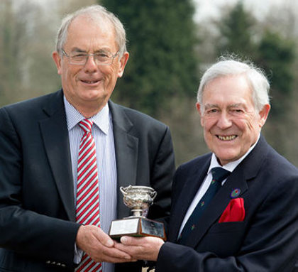 Bill Bryce (right) receives the Micklem Award from Nigel Evans (image © Leaderboard Photography)