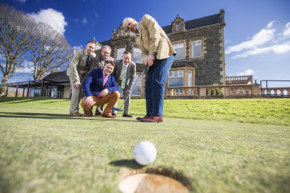 (from left) Paddy Deane, Malone Golf Club; Jim Cullen, Belvoir Park Golf Club; Patrick Aiken, GolfPA.com (kneeling); Simon Wallace, Tourism NI; and, putting out, Greg Bailie, Shandon Park Golf Club.