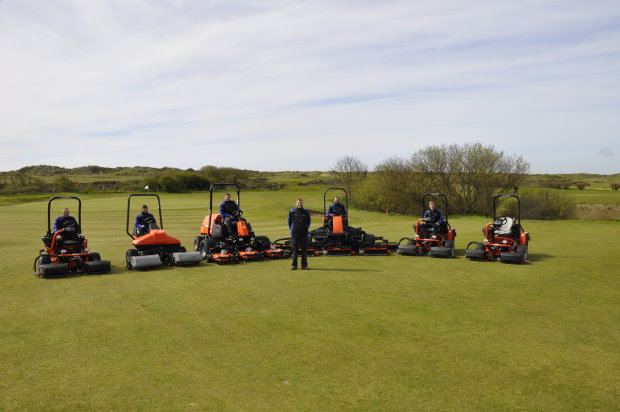 Head Greenkeeper Michael Mead (centre) with his greenkeeping team and the new Jacobsen mowers