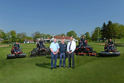 Head greenkeeper Matt Booth, centre, with Tony Dodson from Yorkshire Turf Machinery on the left and Lely's Jeff Anguige with the club's new Toro machines