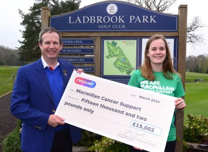 npower's Jason Scagell presents Elisa Beeley from Macmillan a cheque for.£15,002