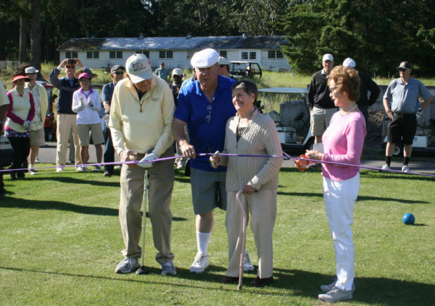 A ribbon cutting was held on the 10th tee featuring Ken Still, Assistant Course Manager Roger Gatts, and the Tatum sisters—whose father, Joe, cut the ribbon for the original nine