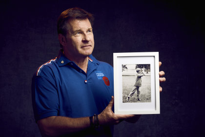 Sir Nick Faldo with a portrait of Albert Tingey, a founding member of The PGA who founded the Niblick Brigade which fought in the Great War (image courtesy of the Royal British Legion) © Mikael Buck / Royal British Legion