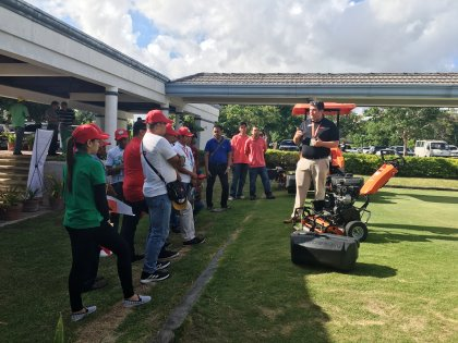 Josh Gagnuss, Jacobsen's Product Support Manager, demonstrating the Eclipse 2 greens mower to conference attendees