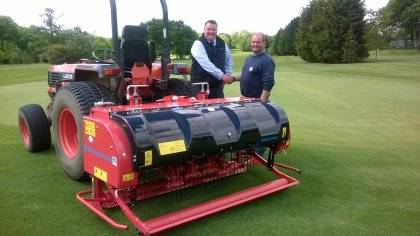 Mark House, Groundcare Area Sales Manager for Ernest Doe Benington (left) delivers a Wiedenmann Terra Spike GXi8 HD deep aerator to Barry Neville, Course Manager at Stanmore Golf Club