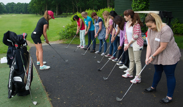 Ladies European Tour star Annabel Dimmock demonstrates the basics of the golf set-up at Stoke Park.