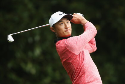 Li Haotong of China tees off on the 2nd hole during day four of the BMW PGA Championship at Wentworth (Photo by Andrew Redington/Getty Images)