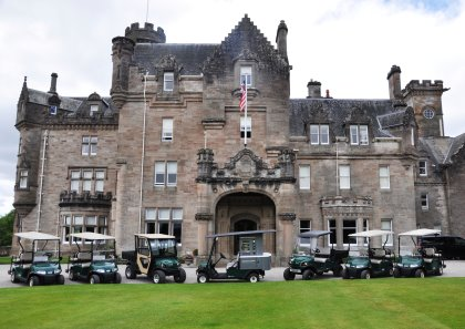 A selection of the vehicles in front of Skibo Castle, with the Cushman Refresher FS2 in the centre