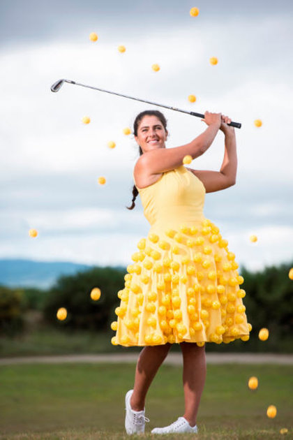 Scottish golf star Kelsey Macdonald has a ball by Wearing It Yellow ahead of the Aberdeen Asset Management Ladies Scottish Open in a dress made from golf balls. Spectators at the tournament are being urged to don yellow clothing to show their support for The Beatson Cancer Charity – the official charity of the event for the second year in a row