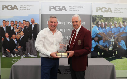 Stewart Russell receiving his Toby Sunderland Award from PGA captain Nicky Lumb (Andy Reddington / Getty Images)