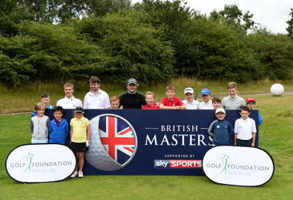 Eddie Pepperell and the kids pose for photographs during the British Masters charity launch at The Grove Hotel on August 10, 2016 in Hertford, England. (Photo by Tom Dulat/Getty Images).