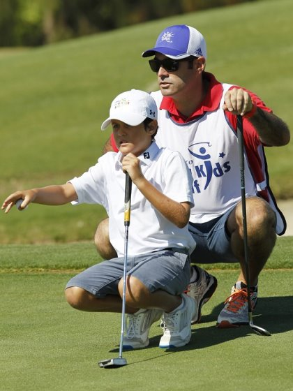 Kostka Horno receives some advice from his caddy