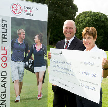 The cheque was presented to chairman Di Horsley from England Golf President-elect John Williams (© Leaderboard Photography)
