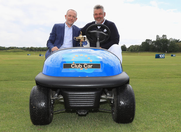 Marco Natale, Vice President of Club Car in EMEA and Darren Clarke, Captain of The 2016 Ryder Cup European team, in the captain's vehicle that will be supplied to Le Golf National in 2018 (Getty Images)