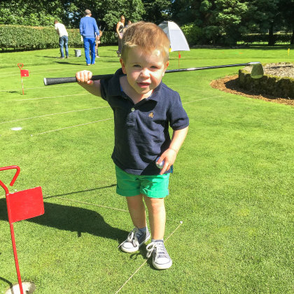 A young first-time golfer tries chipping at Duxbury Park GC during the summer Festival of Golf