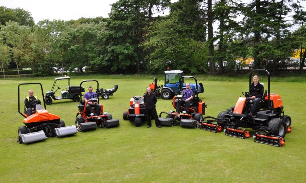 Stuart McBain (centre) with a few team members and a selection of recently purchased machinery from Jacobsen