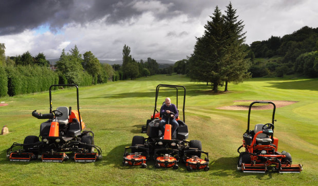 Course Manager, Drew McKechnie, with a few of the recently purchased Jacobsen machines
