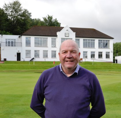 Douglas Park Golf Club Course Manager, Drew McKechnie with  club house behind