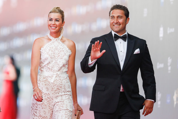 LPGA Tour star Paula Creamer joins her husband on the red carpet during the Mission Hills World Celebrity Pro-Am on the tropical island of Hainan in China