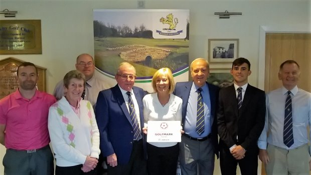 Blackley Golf Club receives their award for GolfMark (from left) Craig Gould, PGA Professional; Barbara Schofield, Management team/ Ladies Competition Secretary; Darron Tickle, Junior Organiser; Barry Wilson, Club President; Debbie Barber County Development Officer for the Lancashire Golf Development Group; Ian Lowe, Club Captain; Elliott Morgan, Junior Captain and Alan Greenwood, Hon Secretary