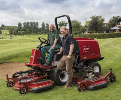 Head greenkeeper of Barnham Broom Golf Club Brian Lemmon seated on the club's Toro Groundsmaster 4000-D, with Reesink Turfcare's Danny Lake