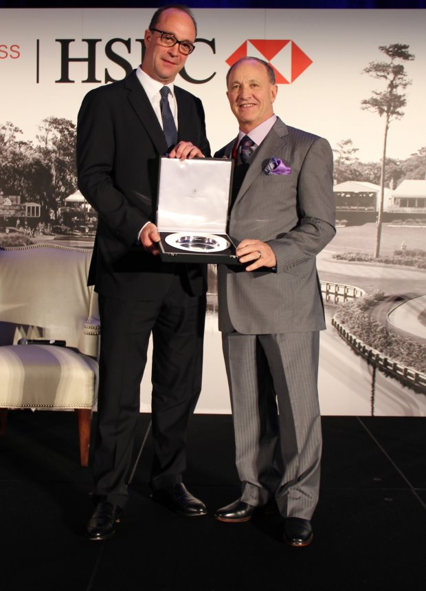Glen Black, owner, president and developer at Air2G2, receives the HSBC Golf Forum Innovation Award from Giles Morgan, HSBC Global Head of Sponsorship and Events
