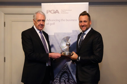 Ian Poulter receives his PGA Recognition Award from PGA captain Nicky Lumb (Jordan Mansfield /Getty Images)