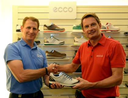 Asian Tour CEO Josh Burack being presented with a ECCO shoe by Jesper S. Thuen, Head of Golf-Asia Pacific