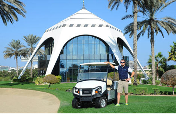 Craig Haldane, Director of Golf Course Maintenance at Dubai Golf, with one of the fleet of Club Car Carryall®vehicles