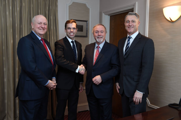 Welsh Government Cabinet Secretary for Economy and Infrastructure Ken Skates and Celtic Manor Resort Chairman Sir Terry Matthews shake hands on the agreements, flanked by Sisk Group Chief Executive Stephen Bowcott and NatWest Relationship Director Stuart Allison