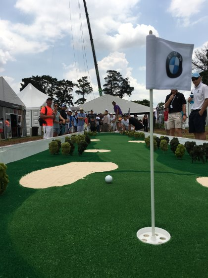 The BMW 'welcome village',featured an imossible long-putt challenge'