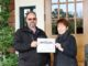 ClearWater prize draw winner Napa Valley Country Club's Assistant Superintendent Todd Schaublin receives the winner's certificate from Human Resource Manager Marsha Lujano