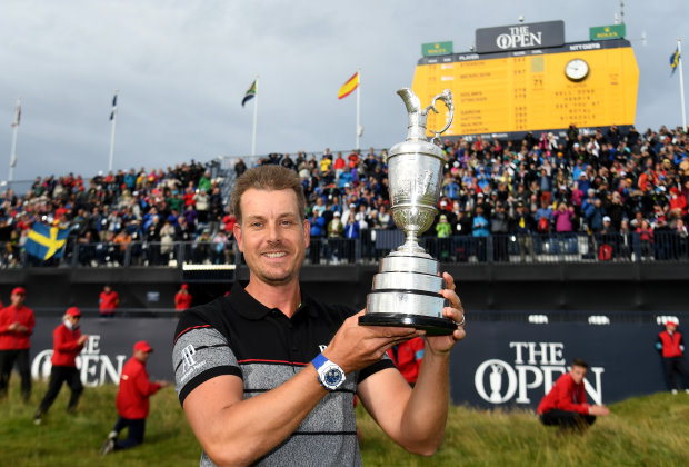Henrik Stenson of Sweden poses with the Claret Jug (photo credit The R&A)