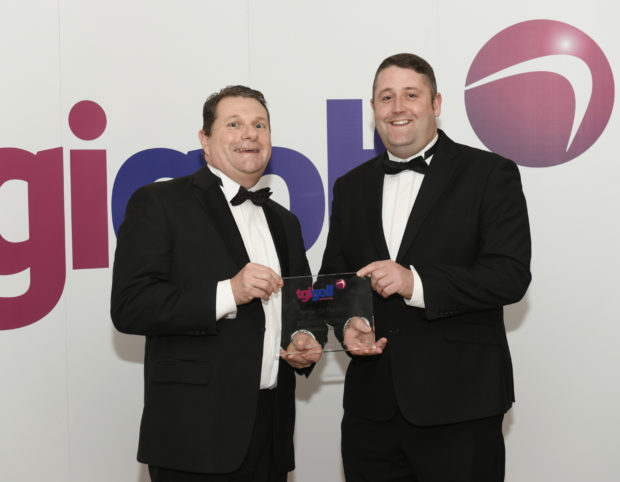 TGI Golf Partner of the Year Stephen Nicholls (left) of Rossendale Golf Club collects his award from previous winner Craig Mackie (Scotscraig GC).
