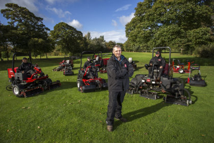Rhuddlan's course manager John Morris, centre, and his greenkeeping team, seated, with their reliable Toro fleet