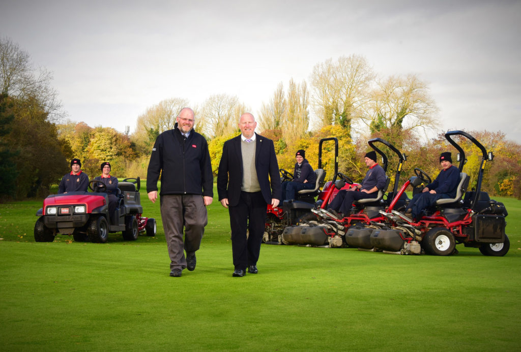 General manager Phil Grice, right, and Reesink's Julian Copping with the club's Toro machines which will be used to help tend 45 holes across two sites