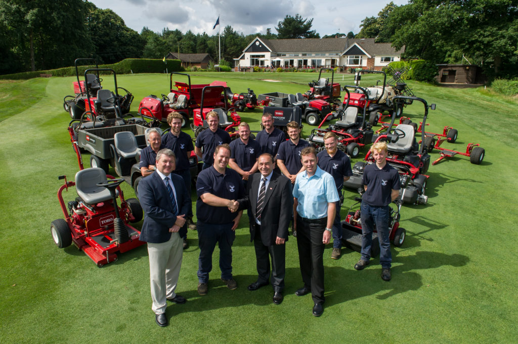 Matt Plested, Stoneham course manager (front middle left) shakes hands with Reesink's John Pike. Richard Arnold, club manager, front left and Richard Sharpe, Kingsworthy Garden Machinery, front right