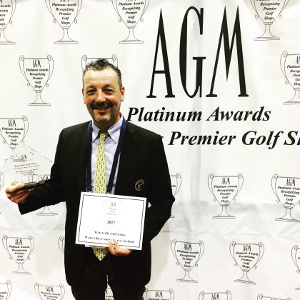 Waterville golf shop manager Brian Higgins with the award