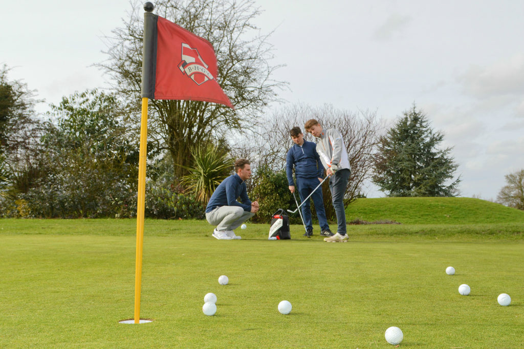 (from left) James Weekley, Ben Flint and a junior golfer during a coaching session at Broke Hill Golf Club