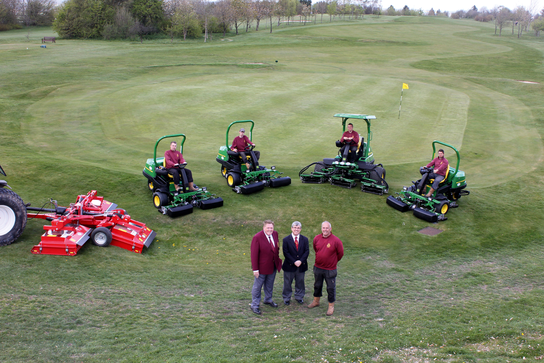 (Front left) Dunstable Downs Golf Club captain Mick Doyle, general manager Duncan Mutton and deputy head greenkeeper Gary Bolton with the greens staff and the new John Deere machinery fleet