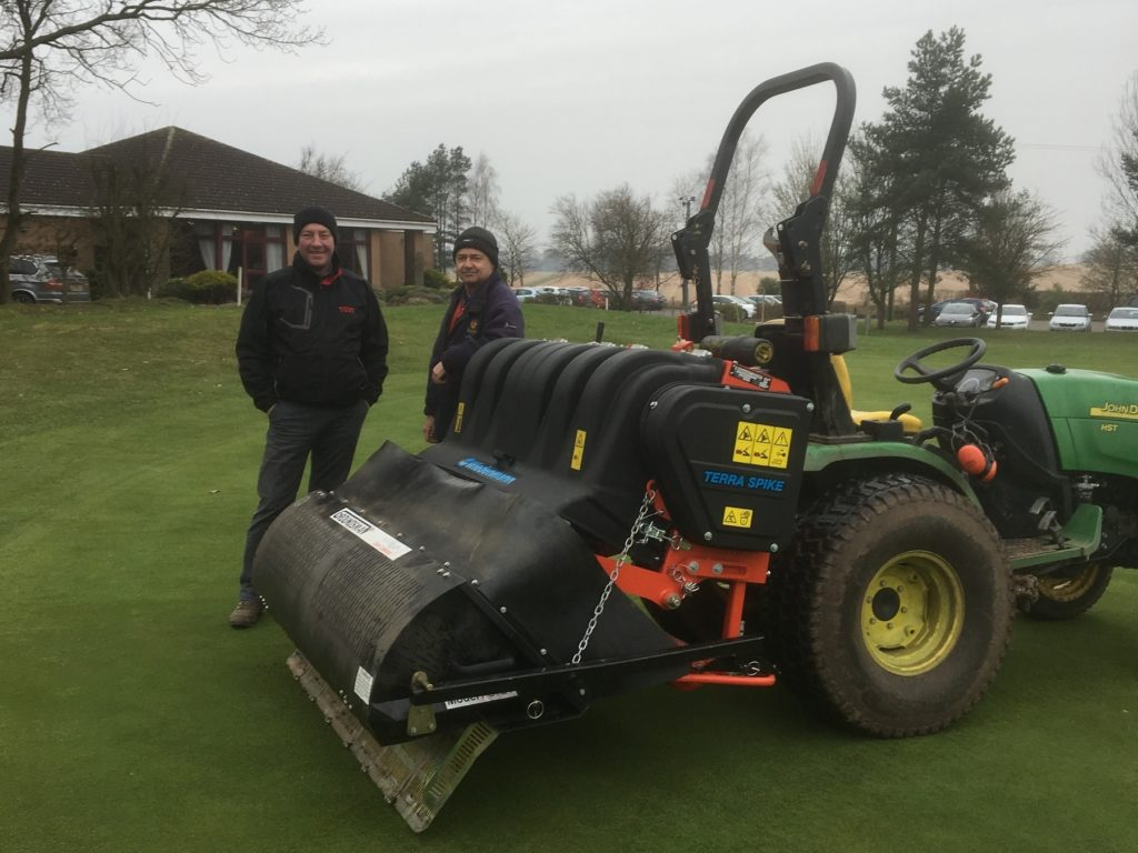Simon Cotterill, (right), Head Greenkeeper at Market Drayton GC with Colin Goldfinch, Regional Manager at Burrows GM, Stafford together with the first delivered Wiedenmann Terra Spike SL after its launch at SALTEX and BTME