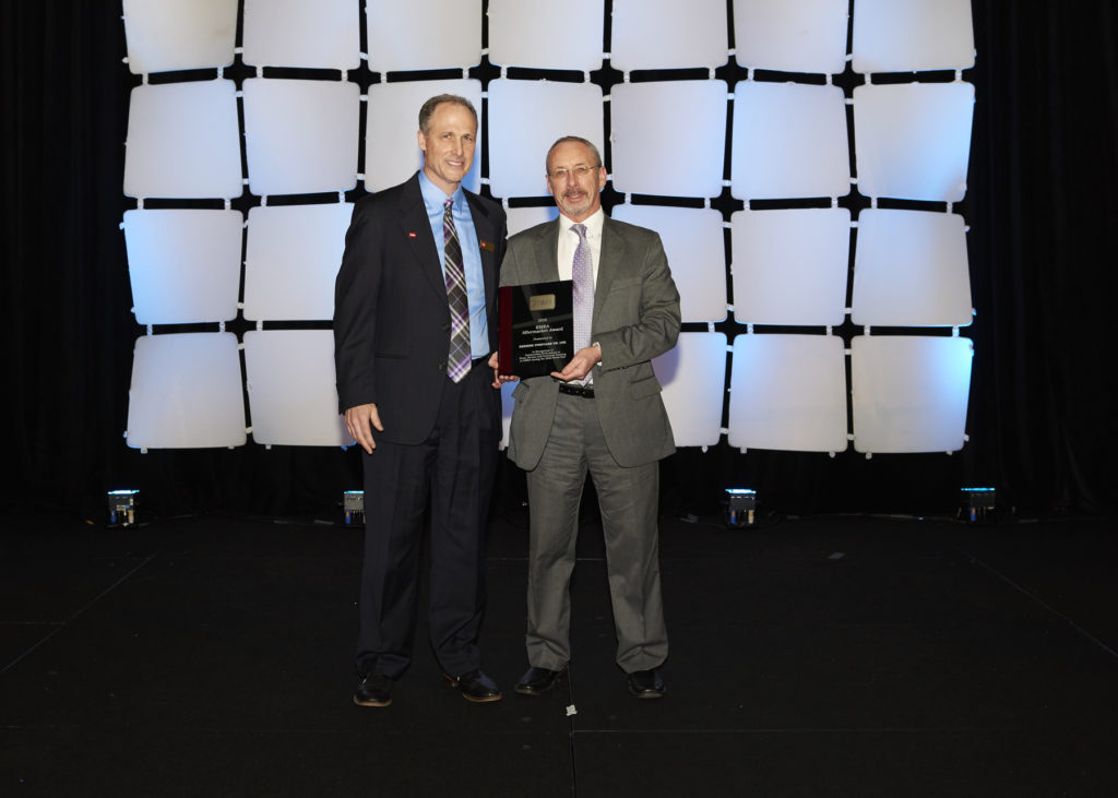 Reesink Turfcare managing director David Cole, right, collects the outstanding performance award from Toro's Brad Nagel